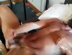 Bearded dude gets shot in the face with jizz from his buddy.