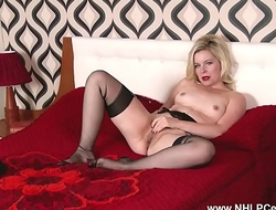 Horny blonde wanks in sheer black nylons