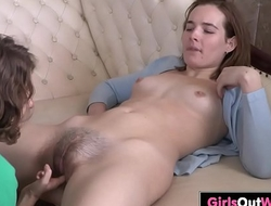 Lesbian chicks lick and finger hairy cunts on the sofa